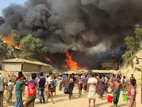 Smoke rises following a fire at a Rohingya refugee camp in Bangladesh (Shafiqur Rahman/AP)