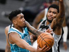 Charlotte Hornets' Malik Monk (left) shoots against San Antonio Spurs' Rudy Gay (Darren Abate/AP)