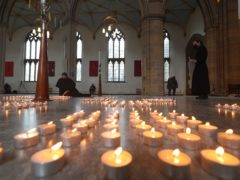 Candles are lit during the National Day of Reflection at Blackburn Cathedral (Peter Byrne/PA)
