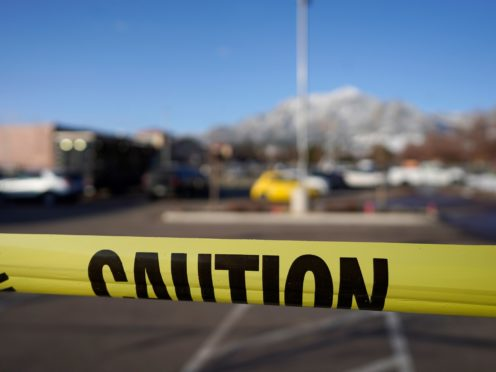 Police tape marks the car park outside the supermarket where the shooting took place (AP/David Zalubowski)
