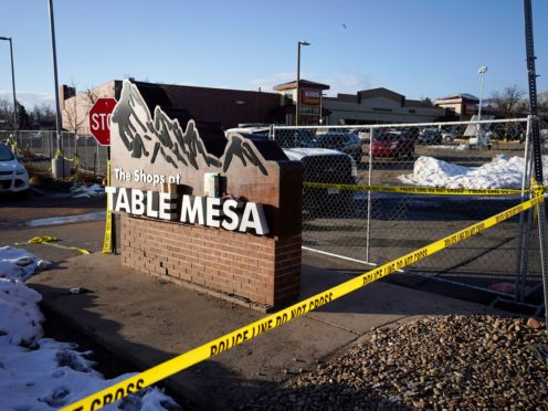 Police tape around the car park outside the supermarket in Boulder, Colorado, where the shooting took place (AP/David Zalubowski)