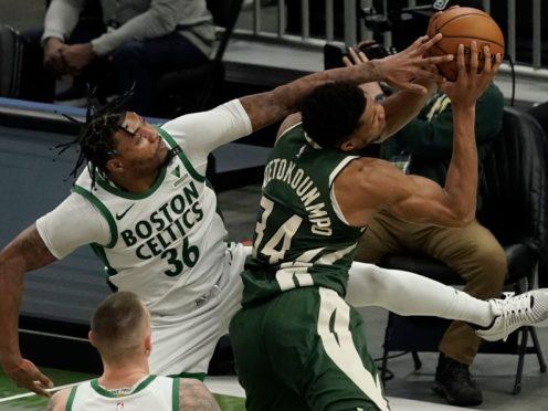 Boston Celtics' Marcus Smart fouls Milwaukee Bucks' Giannis Antetokounmpo (Morry Gash/AP)