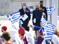 The Prince of Wales and Duchess of Cornwall attend the Independence Day Military Parade in Syntagma Square, Athens (Victoria Jones/PA)