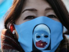 A protester from the Uighur community living in Turkey, participates in a protest in Istanbul (Emrah Gurel/AP)