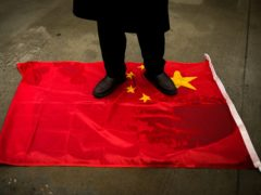 The Britons hit with Chinese sanctions have backed by the Prime Minister and Foreign Secretary (AP/Emrah Gurel)
