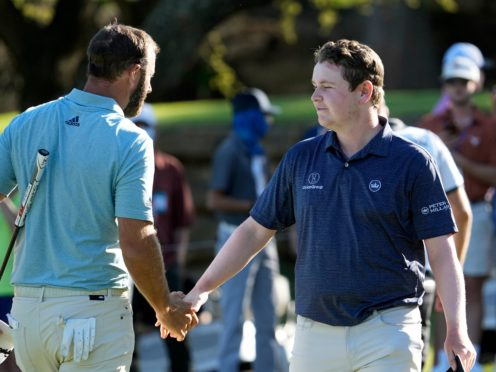 Dustin Johnson shakes hands with Robert MacIntyre after halving their match in the WGC-Dell Technologies Match Play (David J. Phillip/AP)