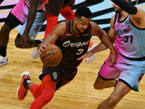 Portland Trail Blazers guard CJ McCollum drives as Miami Heat guard Max Strus defends (Jim Rassol/AP)