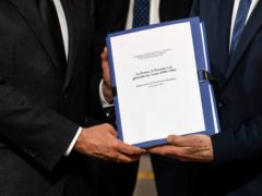 The report on France's role in 1994's Rwandan genocide is given by Historian and Commission chief, Vincent Duclert to French President Emmanuel Macron, at the Elysee Palace, in Paris (Ludovic Marin/AP)