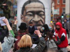 Black Lives Matter demonstrators take a knee (Peter Byrne/PA)