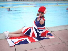Jessica Walker sits next to the water at Hillingdon Lido in Uxbridge, west London, on the first day of a major easing of England's coronavirus lockdown to allow far greater freedom outdoors (PA)