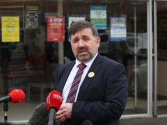 Minister for Heath, Robin Swann, speaks to the media outside Timoney Pharmacy in Lambeg (Liam McBurney/PA)