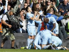 File photo dated 13-05-2012 of Manchester City Sergio Aguero celebrates scoring the winning goal during the Barclays Premier League match at the Etihad Stadium, Manchester. Issue date: Monday March 29, 2021.