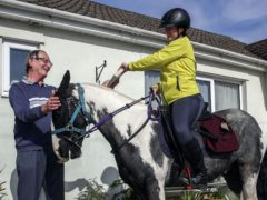 Rescue pony Micky helps owner Abi Eliot-Williams deliver library books to the Hullavington Book Group (Steve Parsons/PA)