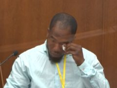 In this image from video, witness Donald Williams wipes his eyes as he answers questions, as Hennepin County Judge Peter Cahill presides Tuesday, March 30, 2021, in the trial of former Minneapolis police officer Derek Chauvin at the Hennepin County Courthouse in Minneapolis, Minn. Chauvin is charged in the May 25, 2020 death of George Floyd. (Court TV via AP, Pool)