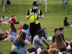 Police officers confiscate alcohol at the Forest Recreation Ground in Nottingham (Jacob King/PA)