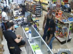 George Floyd, right, is seen inside Cup Foods (Court TV via AP, Pool)