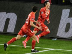 North Macedonia's Eljif Elmas, right, celebrates his late winner in Germany (Thilo Schmuelgen/Pool via AP)