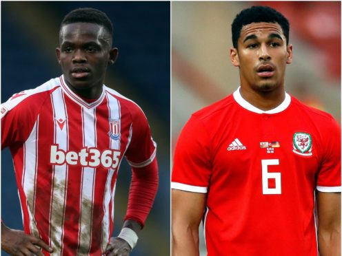 Wales players Rabbi Matondo and Ben Cabango were racially abused online (PA)