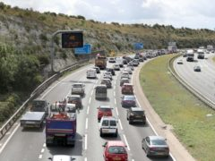 Traffic begins to build on the M3 near to Winchester in Hampshire ahead of the bank holiday weekend. Drivers are being warned to expect delays as more than 14 million cars take to the roads for leisure trips between Thursday and Monday, according to the RAC.