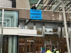 A lone Extinction Rebellion protester climbed onto the roof of the Scottish Parliament (Extinction Rebellion)