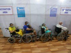 Elderly Indians wait to receive a Covid-19 vaccine in Mumbai (Rafiq Maqbool/AP)