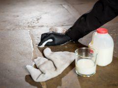 English Heritage conservators try washing flag stone floors with milk (English Heritage/PA)