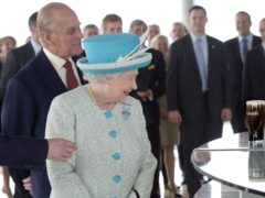 The Queen and the Duke of Edinburgh admire a pint of Guinness at the Guinness Storehouse during the second day of her State Visit to Ireland (Arthur Edwards/The Sun/PA)