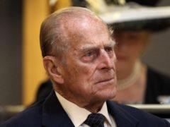 The Duke of Edinburgh listens as the Queen makes a speech in the Siambr (Chamber) (Matt Cardy/PA)