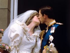 Diana and Charles kiss on the Palace balcony on their wedding day (PA)