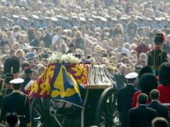 The gun carriage carrying the coffin of the Queen Mother (PA)