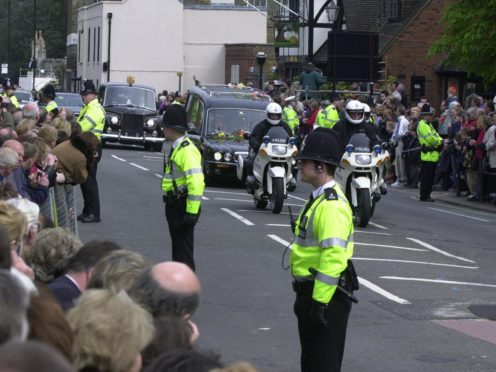Police line the route of the Queen Mother's funeral cortege in Windsor (Tim Ockenden/PA)