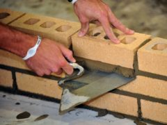 A trainee bricklayer at work (Ian Nicholson/PA)
