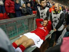 David Beckham suffered a broken foot playing for Manchester United on this day in 2002 (Martin Rickett/PA)