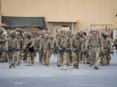 Some of the last British troops head towards the flight line as they prepare to leave Camp Bastion, Helmand Province, Afghanistan (PA)