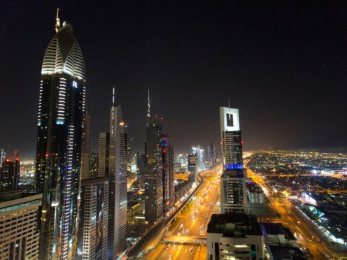 A view of the skyline at night of Dubai (Yui Mok/PA)