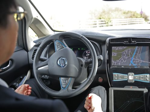 Self-driving cars enabling drivers to take their eyes off the road and their hands off the wheel could be permitted on UK motorways later this year (Philip Toscano/PA)