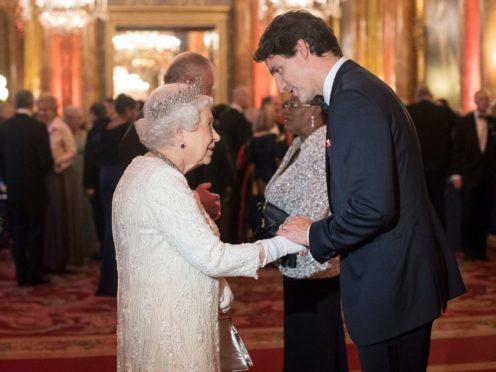 The Queen greets Canada's Prime Minister Justin Trudeau (Victoria Jones/PA)