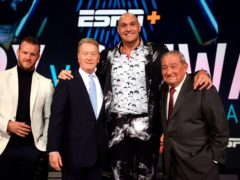 Bob Arum (right) does not believe Tyson Fury (second right) will fight Anthony Joshua this summer (Kirsty O'Connor/PA)