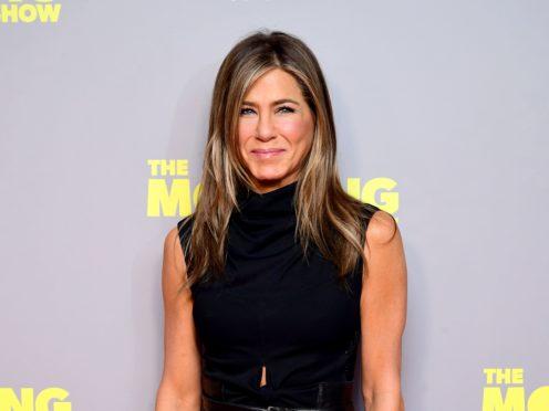 Jennifer Aniston joked about Paul Rudd's famously youthful appearance as she wished him a happy birthday (Ian West/PA)