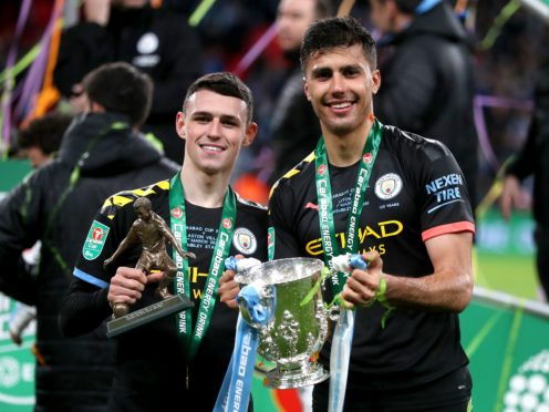 Manchester City are hoping to retain their grip on the Carabao Cup (Mike Egerton/PA)