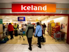 Elderly shoppers enter the branch of Iceland in the Kennedy Centre, Belfast (Liam McBurney/PA)