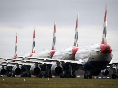 Nicola Sturgeon says that international travel still poses a Covid risk to Scotland (Andrew Milligan/PA)