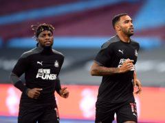 Newcastle United's Allan Saint-Maximin and Callum Wilson (right) warm up before the Premier League match at London Stadium.