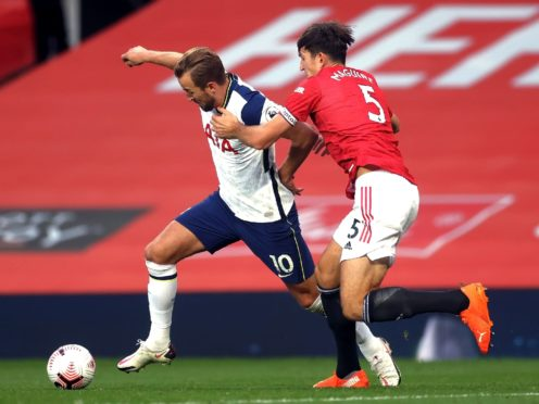 Harry Maguire and Harry Kane will go head to head on Sunday (Carl Recine/PA)