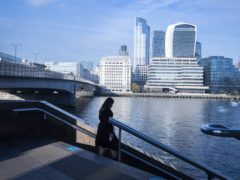 A woman walks down steps across from the City of London (Victoria Jones/PA)