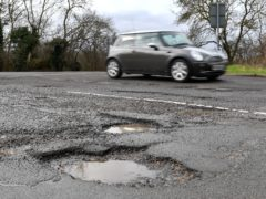 File photo dated 04/04/18 of a pothole in Cambridgeshire. Pothole-plagued local roads are the UK's most widespread motoring concern, a new survey suggests.