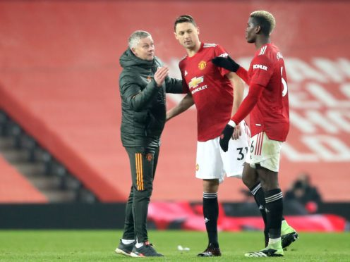 Ole Gunnar Solskjaer says the red stadium wrap at Old Trafford has been problematic (Martin Rickett/PA)