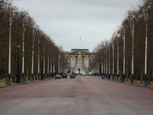 A man who was arrested after allegedly carrying an axe near Buckingham Palace is to appear in court (Luciana Guerra/PA)