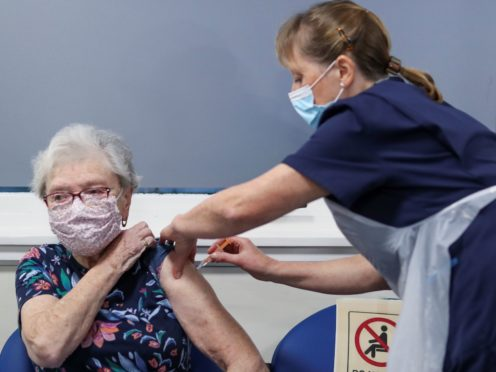 People are being urged to have their vaccination (Russell Cheyne/PA)