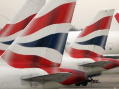 British Airways' owner has announced it is the first European airline group to commit to powering 10% of its flights with sustainable jet fuel by 2030 (Tim Ockenden/PA)